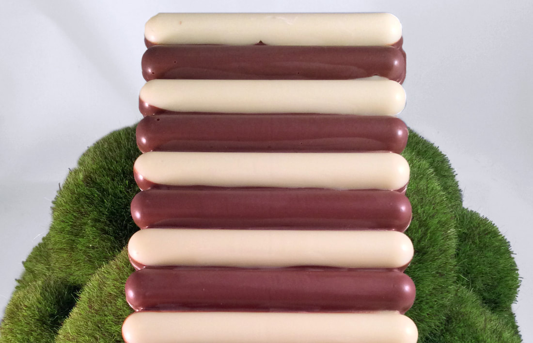 Bar with rotating strips of white and milk chocolate.